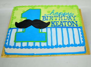 MaArthur's Bakery Custom Cake with Large Blue Number One and Black Mustache