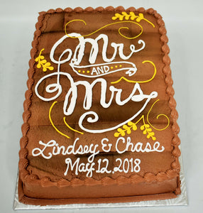 MaArthur's Bakery Custom Cake with Wooden Look Background with Mr. and Mrs. in Fancy Script
