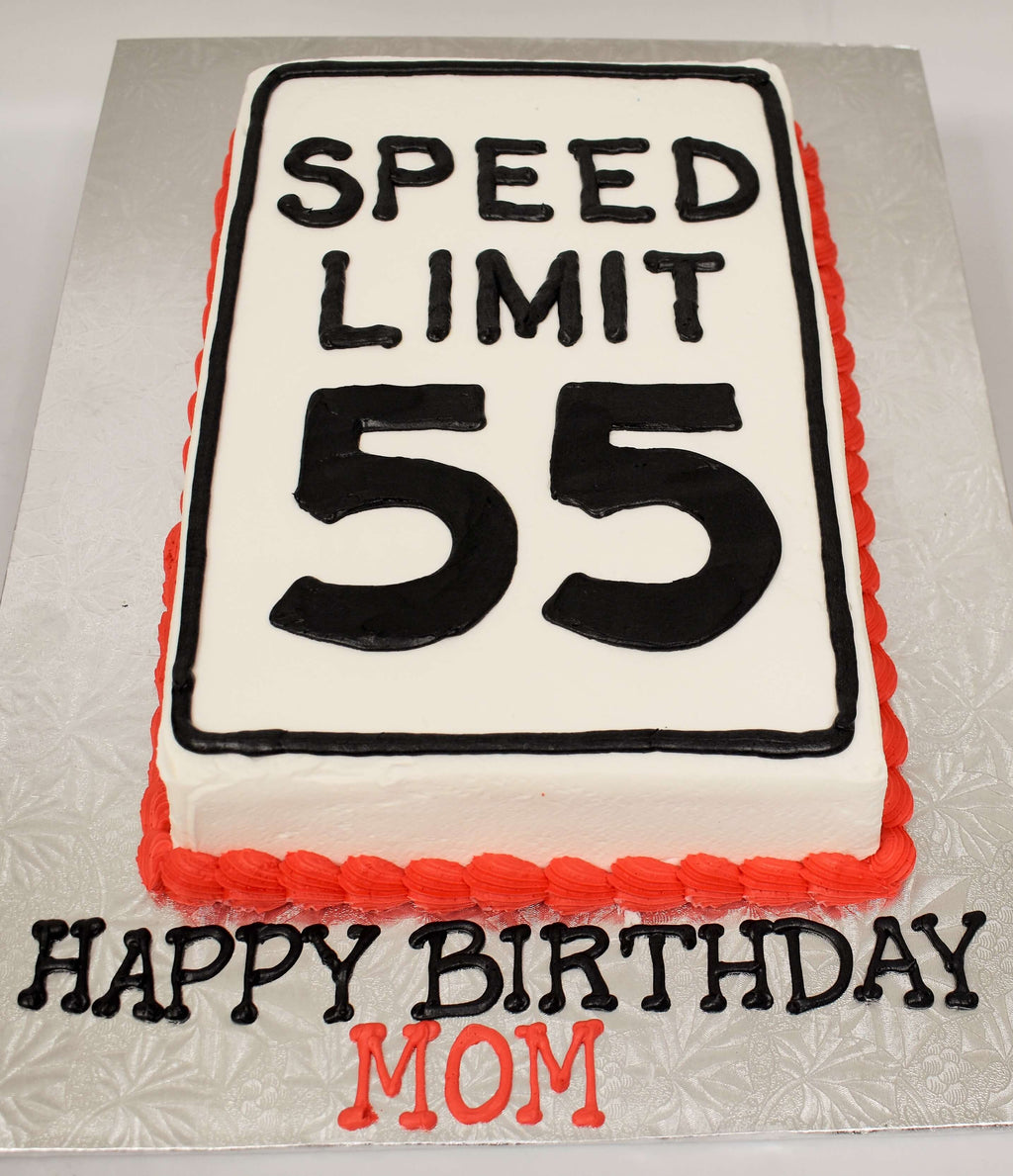 MaArthur's Bakery Custom Cake with the Words Speed Limit 55 Written in Black