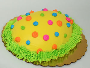 McArthur's Bakery cake design as a yellow Easter egg with dots.