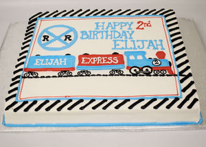 McArthur's Bakery Custom Cake with Blue and Red Train, Rail Road Crossing Sign and Tracks