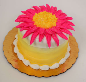 MaArthur's Bakery Custom Cake with a Single Large Pink Flower and Yellow Sides