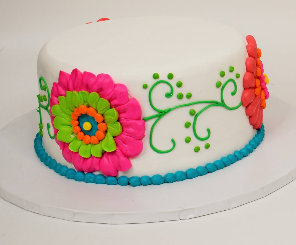 McArthur's Bakery Custom Cake with Large Festive Flowers on Side of Cake