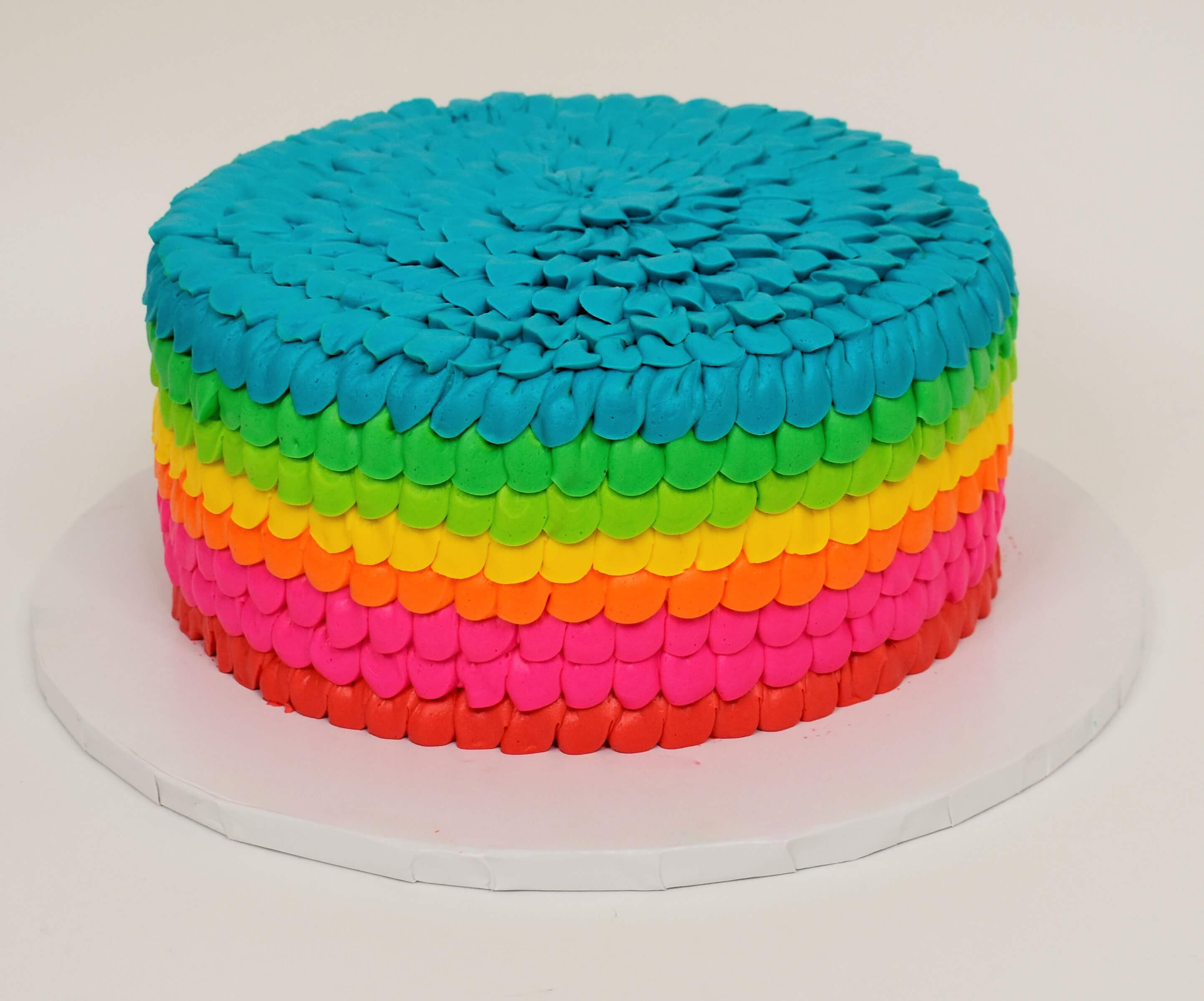 MaArthur's Bakery Custom Cake With Rainbow Ruffles.