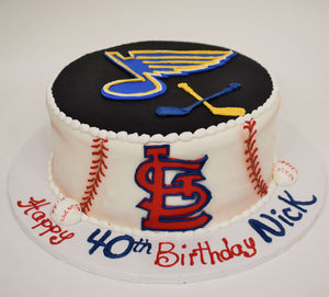 MaArthur's Bakery Custom Cake With Blues Noteand Hockey Sticks on top, Cardinals logo Baselball Stiching on side