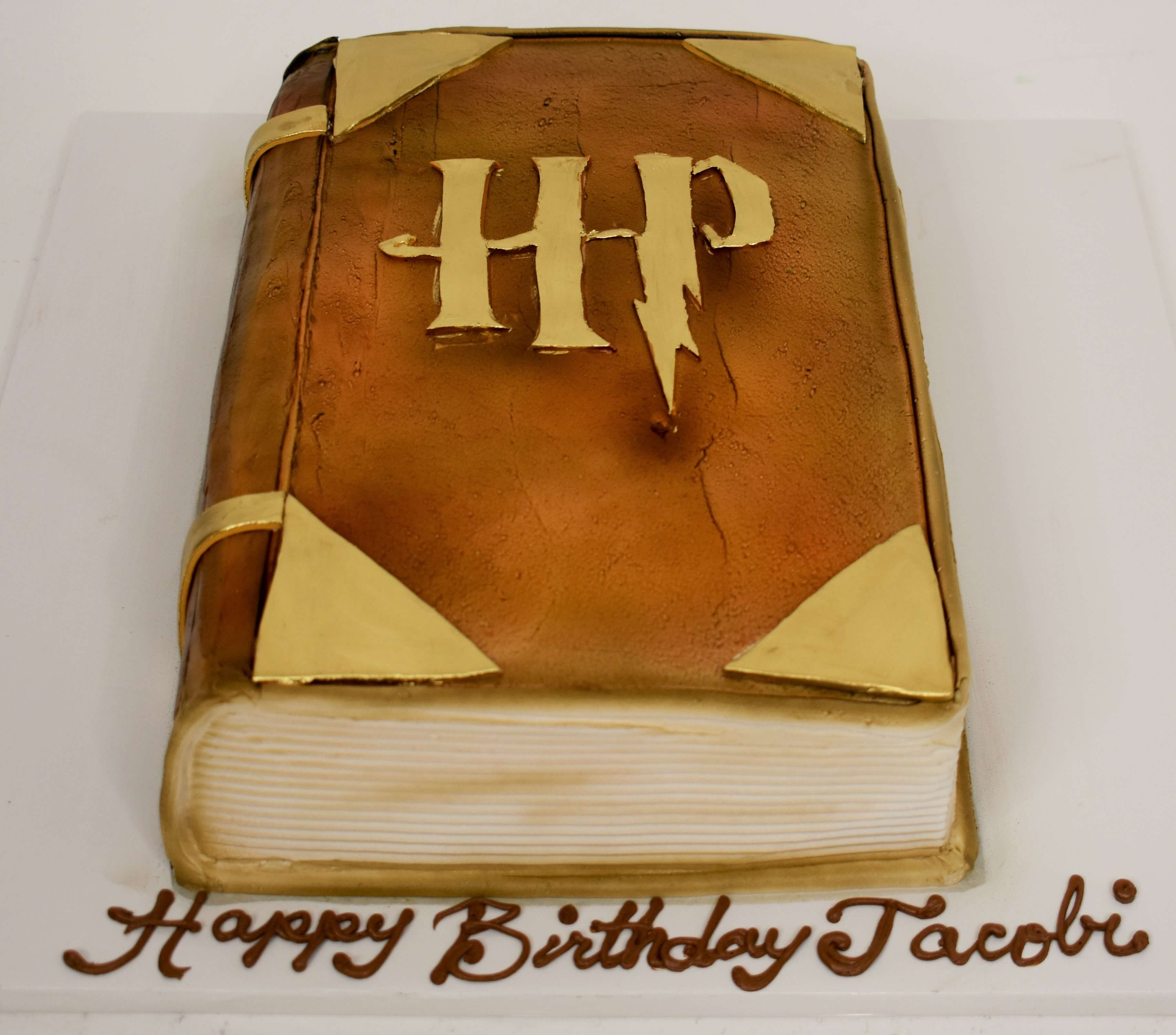 McArthur's Bakery Custom Cake with a Harry Potter Book Cut Out
