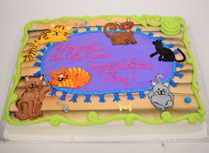 MaArthur's Bakery Custom Cake Sprayed Blue, with Mutiple Cats Laying on a Rug.