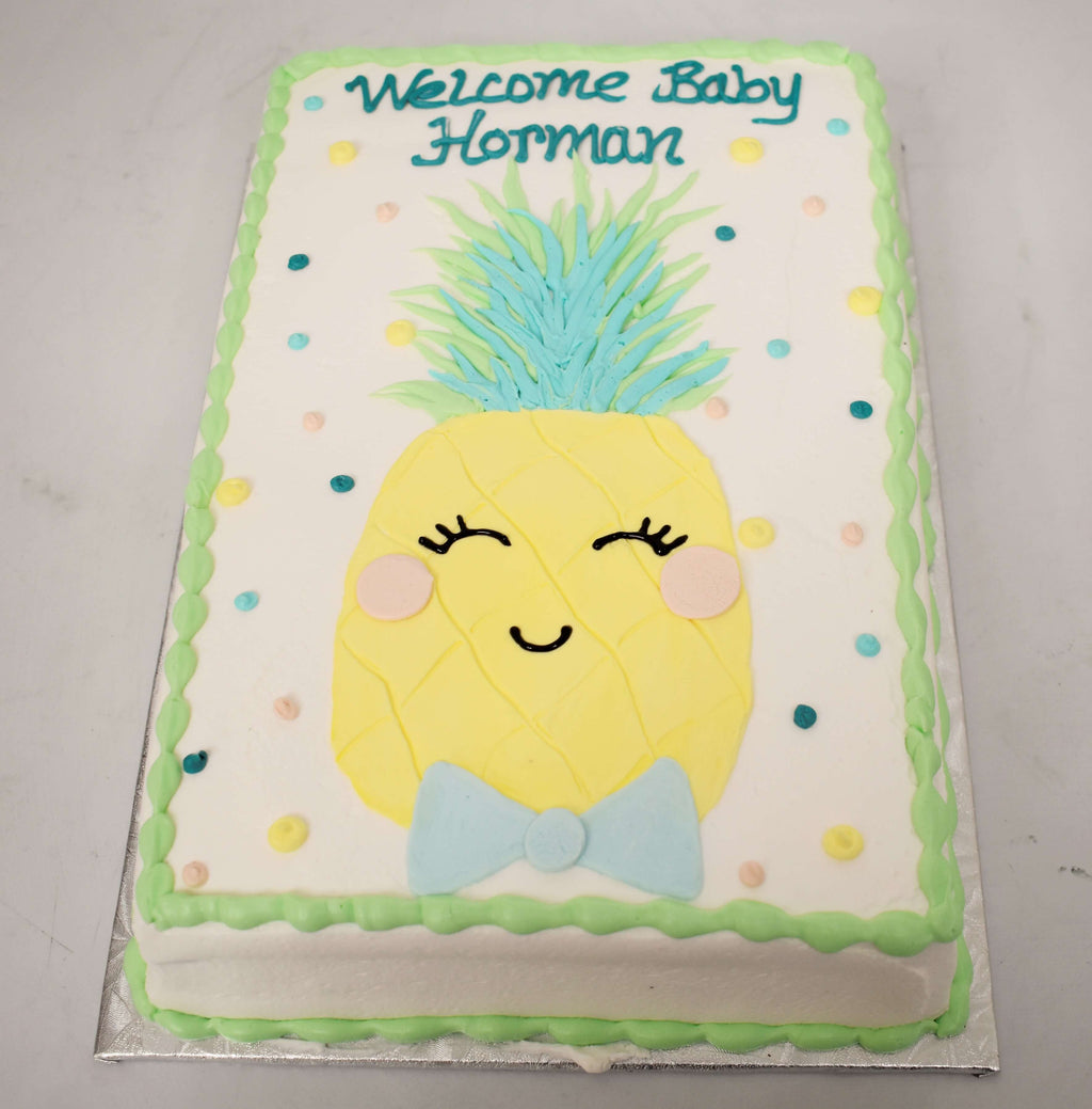 MaArthur's Bakery Custom Cake with Smiling Pineapple, Bowtie, Polka Dots