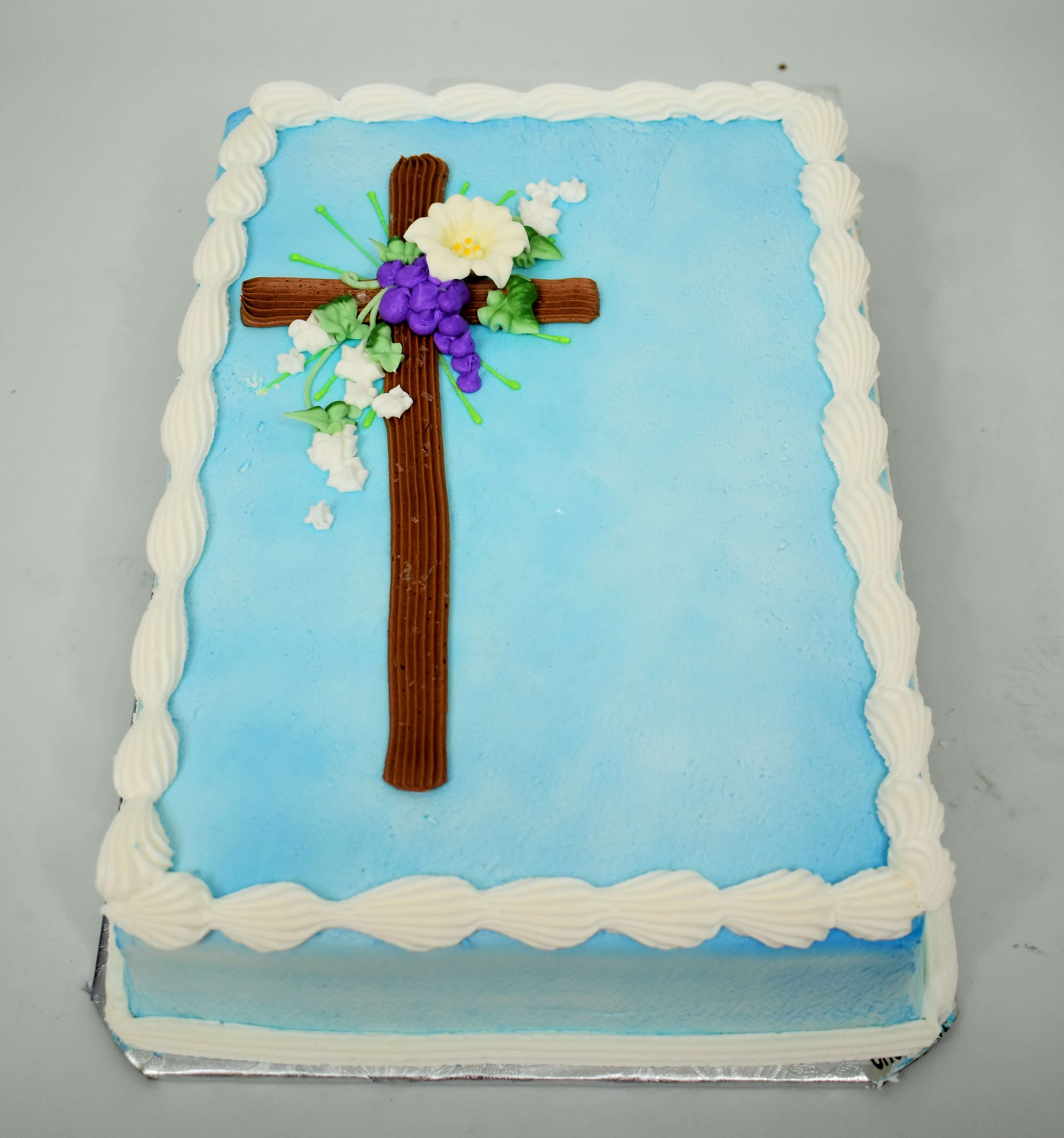 MaArthur's Bakery Custom Cake Sprayed Blue, with Brown Cross, Purple Grapes and Flowers
