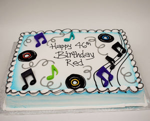 MaArthur's Bakery Custom Cake With Blue Airspray, Musical Notes, Records, Silver Swirls