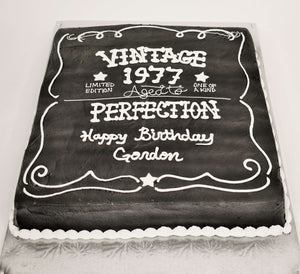 MaArthur's Bakery Custom Cake With Black Icing, White Writing, Aged to Perfection