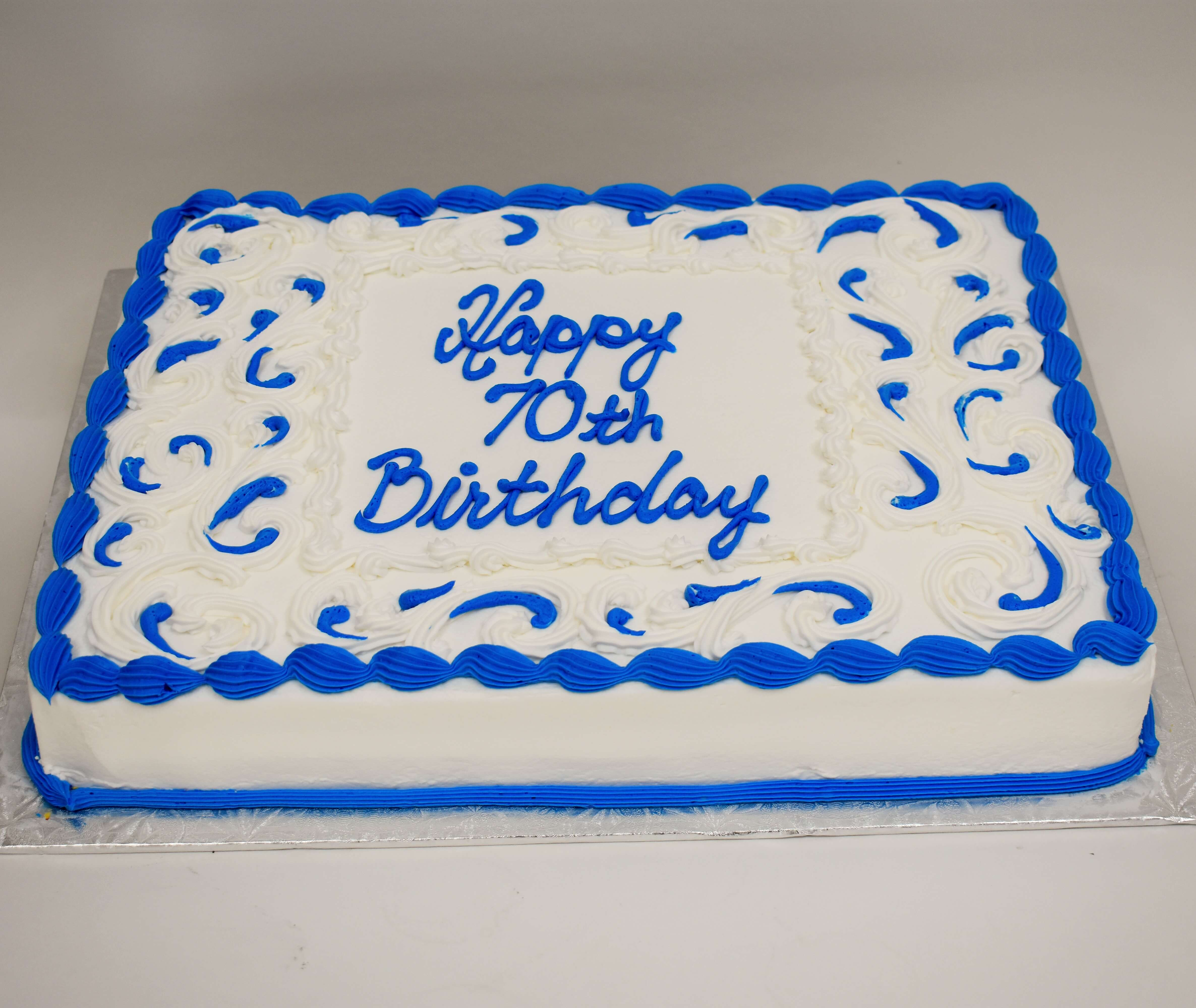 MaArthur's Bakery Custom Cake with Blue and White Icing Scrolling