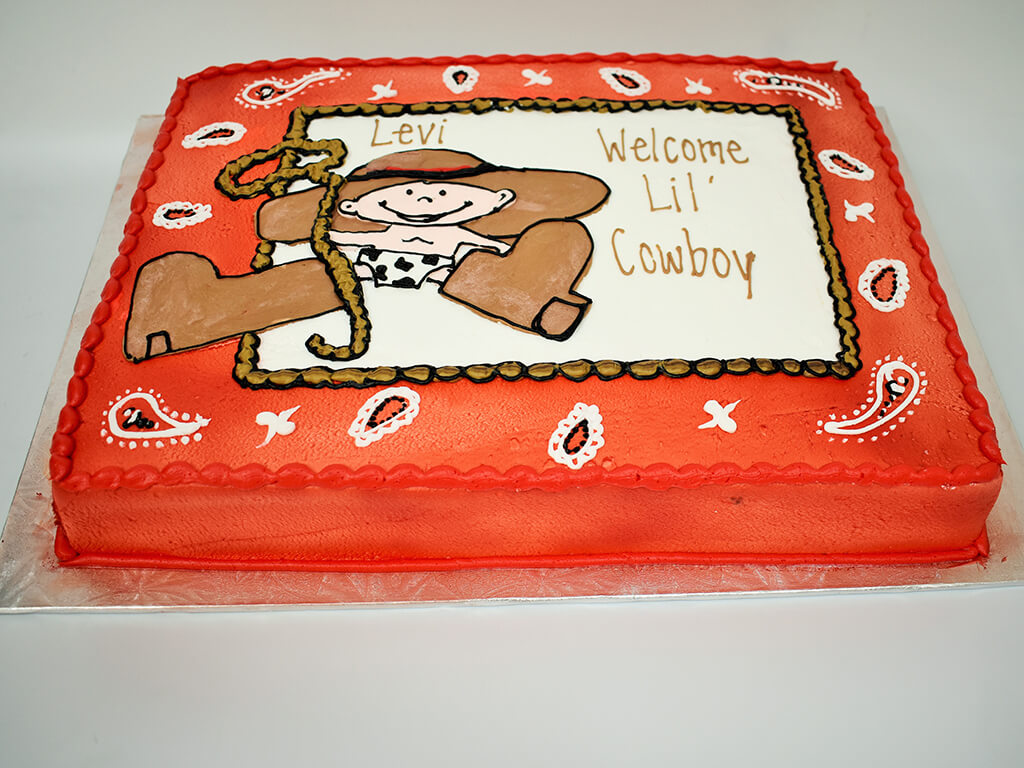 McArthur's Bakery Custom Cake with A Baby Cowboy and Lasso Welcoming A New Baby