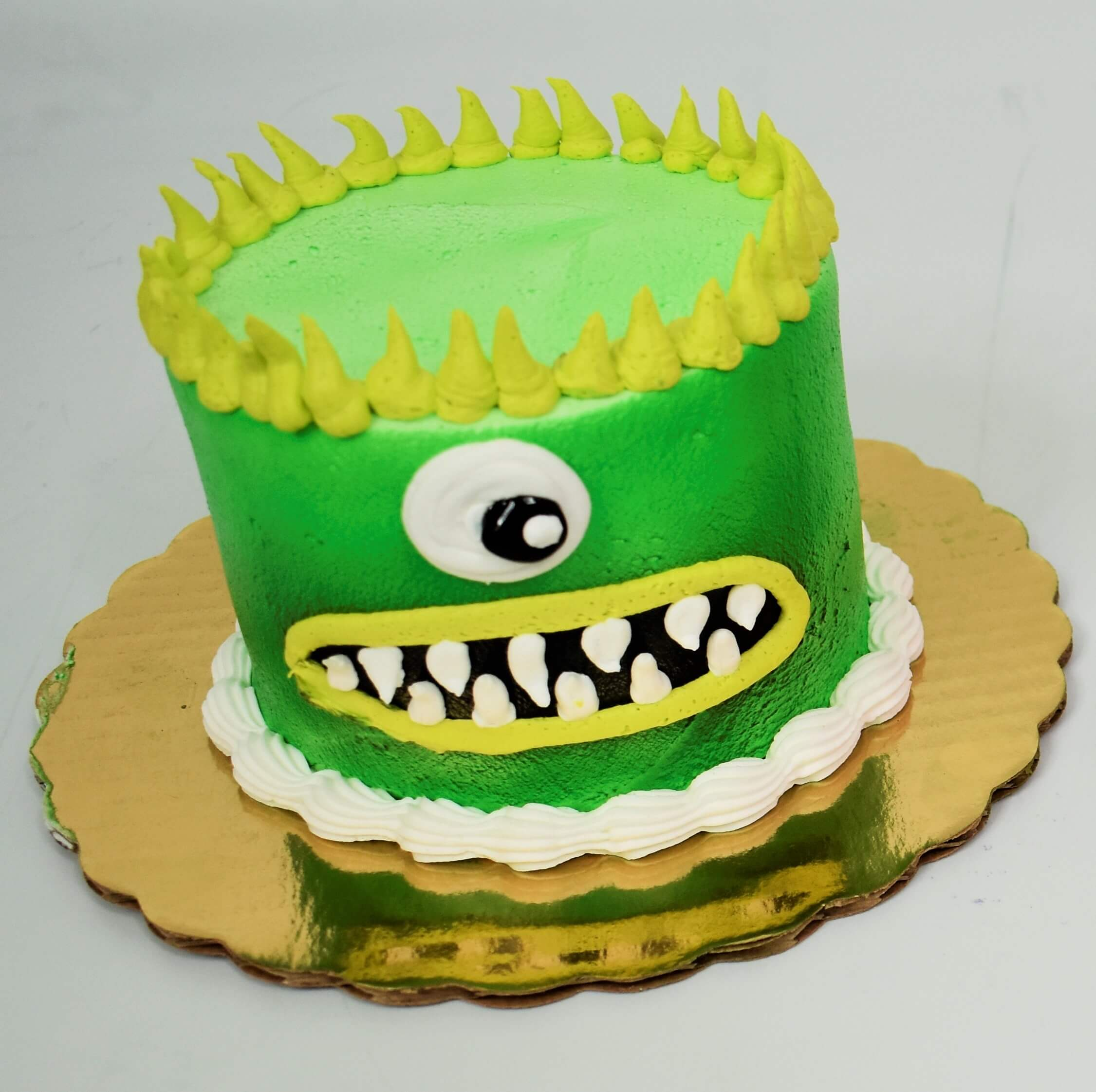 MaArthur's Bakery Custom Cake with Green Monster Face, One eye, Yellow Spikey Hair