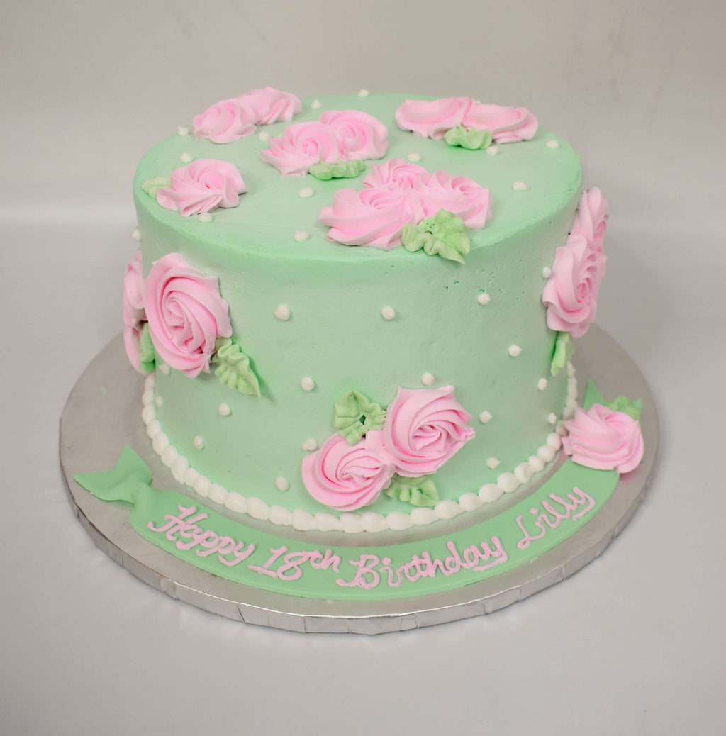 McArthur's Bakery Custom Cake with Pink Rosette, White Polka Dots, Mint Green background