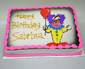 McArthur's Bakery Custom Cake with Scary Clown, Holding a Balloon, Purple Hair, Yellow Outfit.