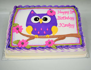 MaArthur's Bakery Custom Cake with a Purplr Owl, Branch, Pink Flowers