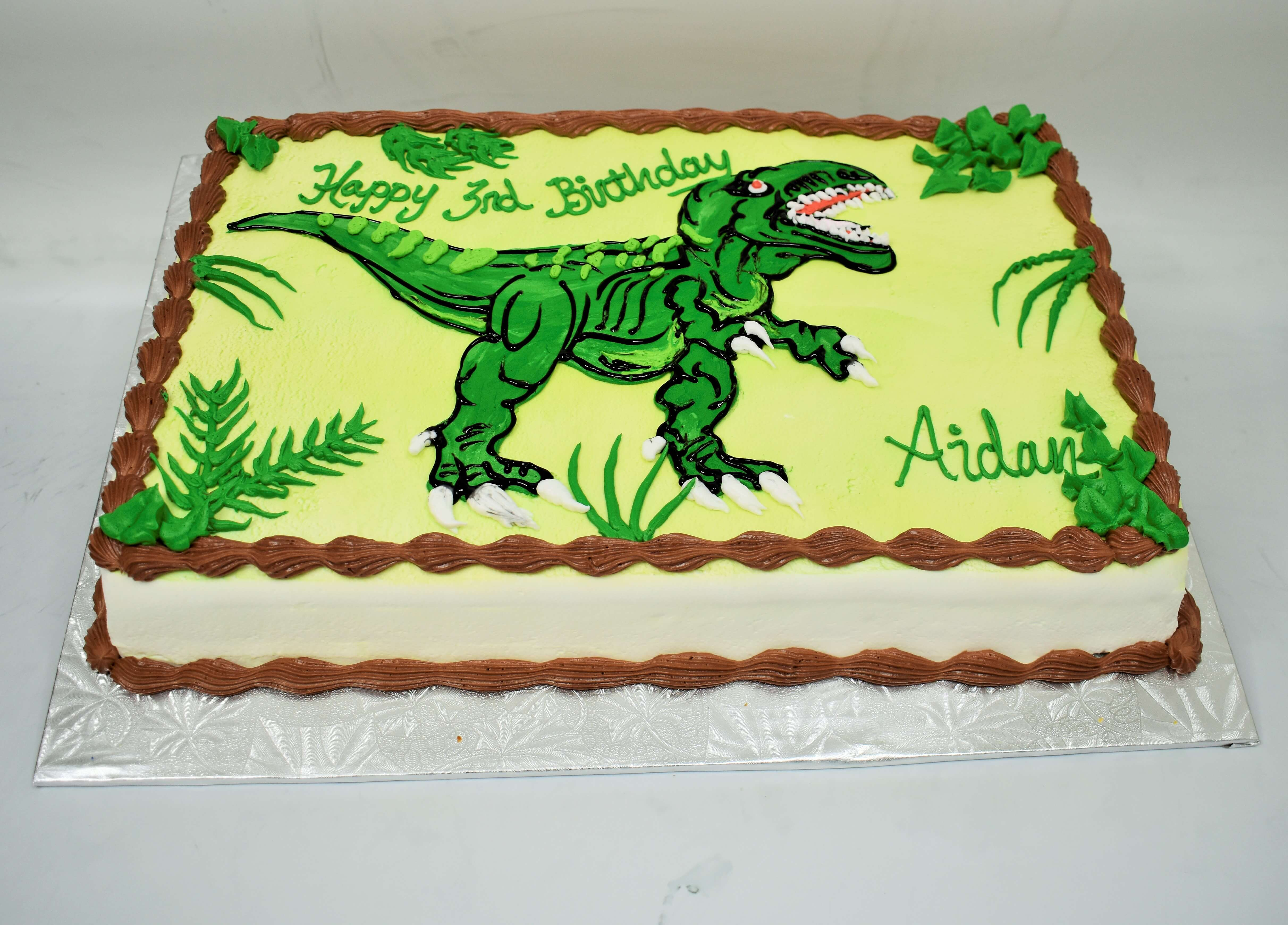 MaArthur's Bakery Custom Cake with T-Rex Standing around Leafy Plants