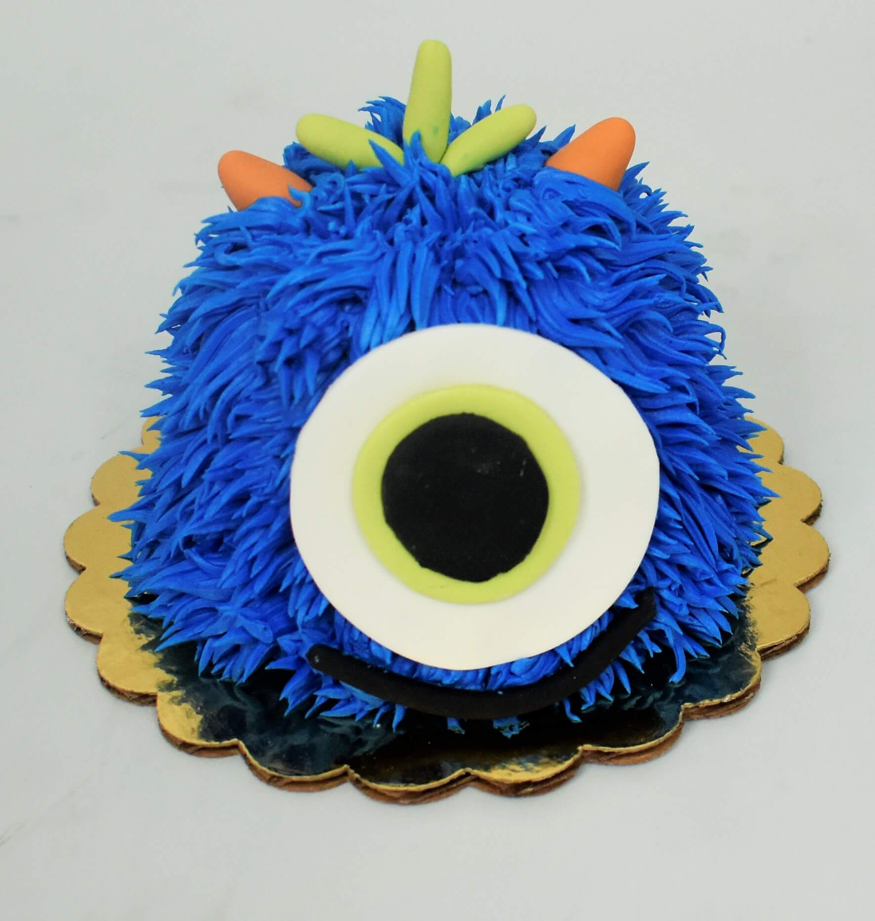 MaArthur's Bakery Custom Cake with One Eye, Blue Hair