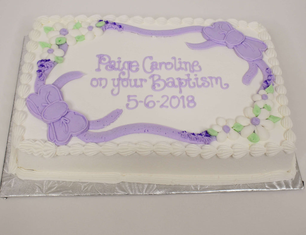 MaArthur's Bakery Custom Cake with Purple Icing Bows and white and Purple Flowers