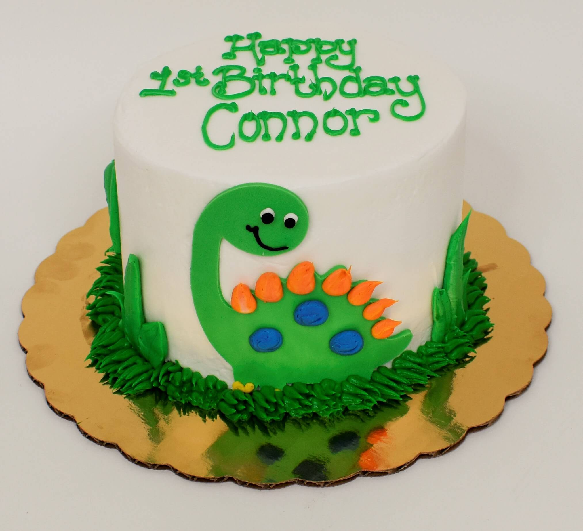 McArthur's Bakery Custom Cake with Green Dinasour and Green Grass