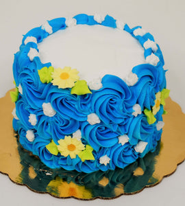 MaArthur's Bakery Custom Cake With Blue Rosettes, Yellow and White Flowers