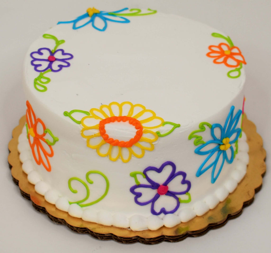 MaArthur's Bakery Custom Cake With Colorful Outline Flowers Covering Top and Sides of Cake