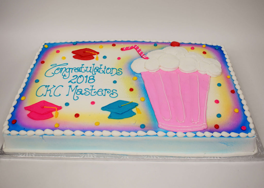 McArthur's Bakery Custom Cake with Pink and Purple Icing, Milk Shake and Graduation Hats
