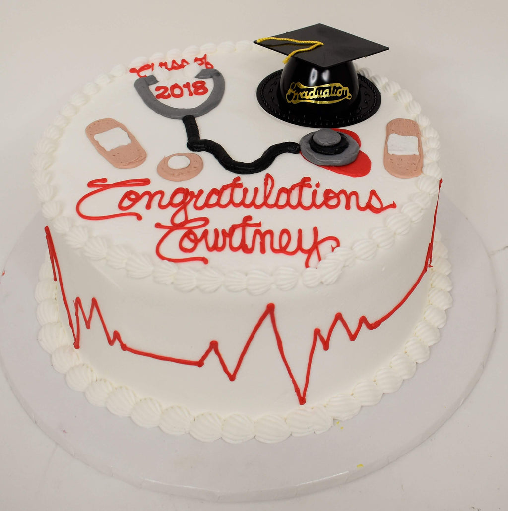 MaArthur's Bakery Custom Cake With Graduation Cap, Band Aids and Stethoscope