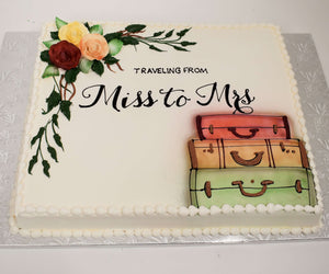 MaArthur's Bakery Custom Cake with Mr. & Mrs. with Suitcases and Roses
