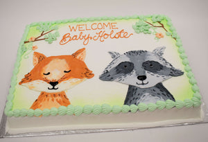 MaArthur's Bakery Custom Cake with Fox and Racoon Faces, Green Background