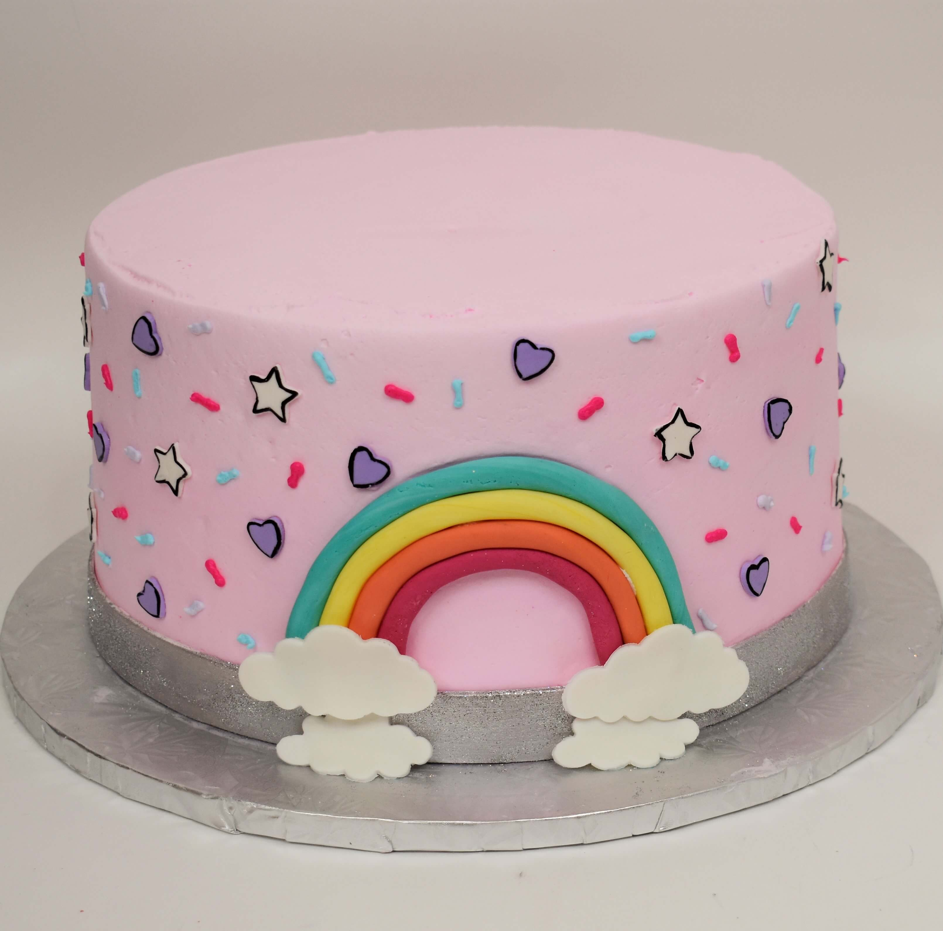 McArthur's Bakery Custom Cake with Rainbows, Hears, Stars, Sprinkles, Pink Icing
