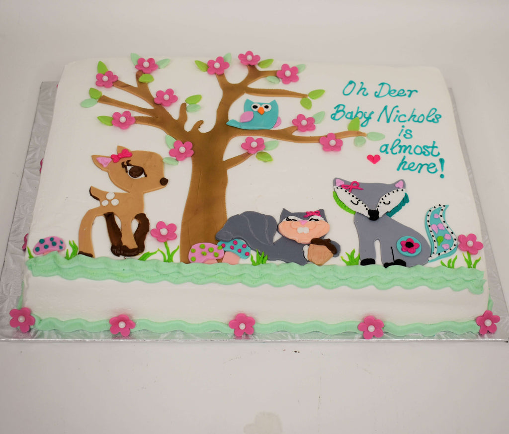MaArthur's Bakery Custom Cake with Woodland Animals, Deer, Squirrel, Owl, Fox, Pink Budding Flowers.