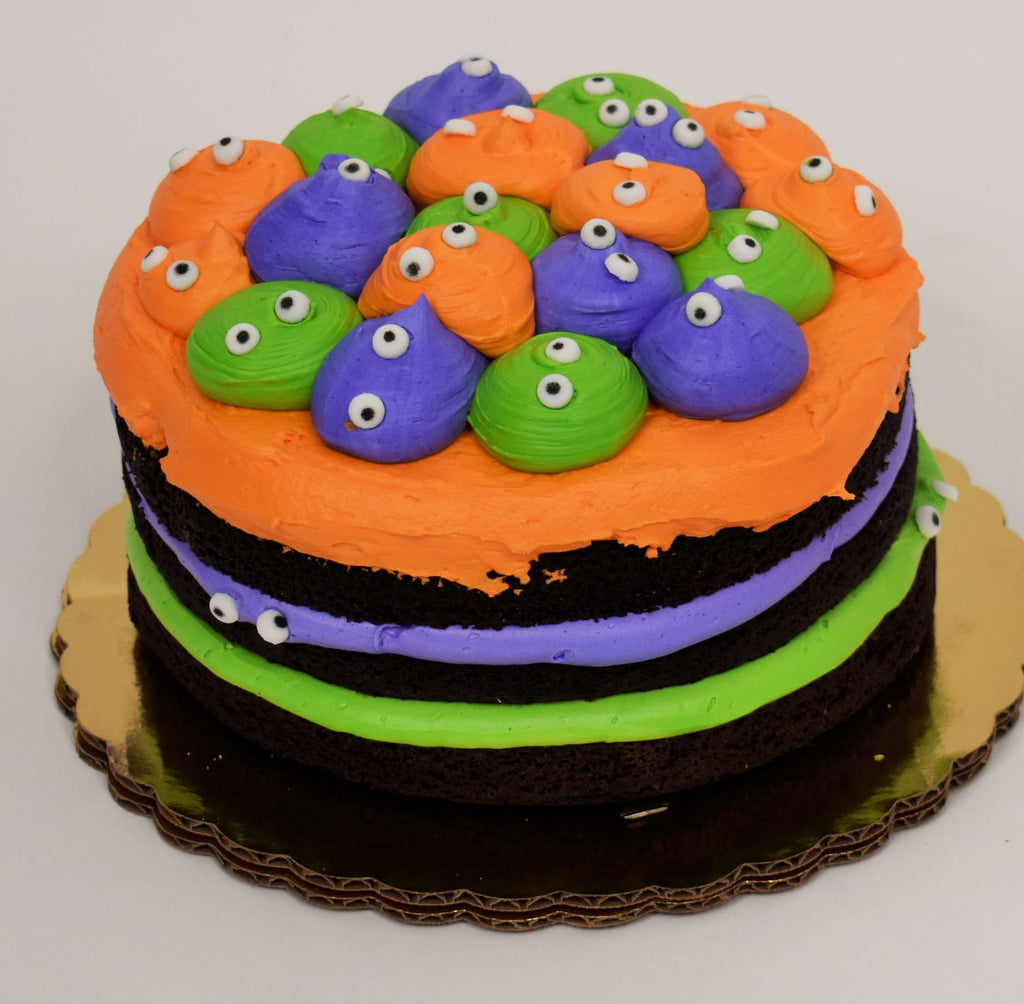 MaArthur's Bakery Custom Cake with Orange, Purple, and Green Heads with Eyes.