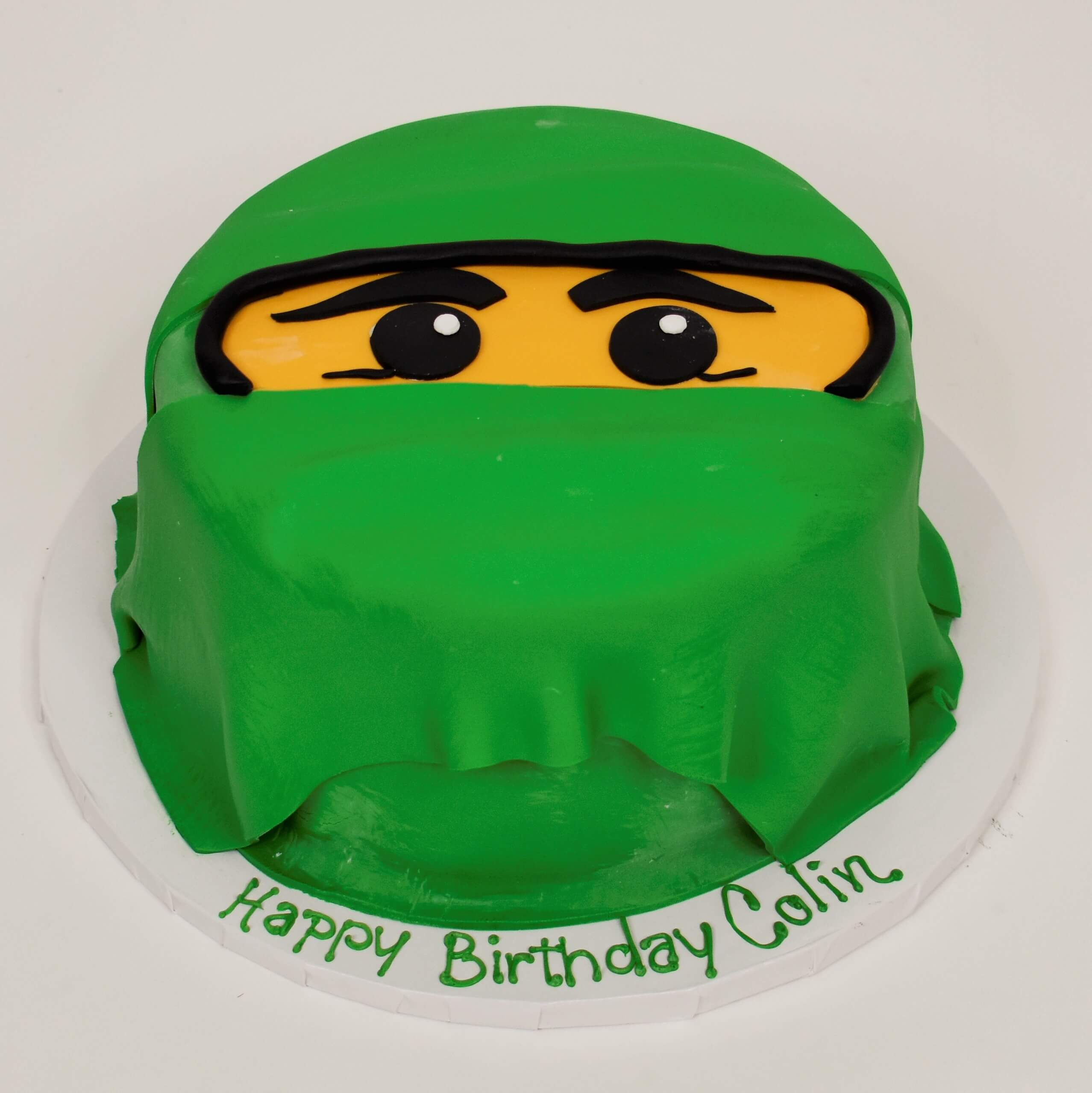 McArthur's Bakery Custom Cake with Yellow Face, Green Overlay
