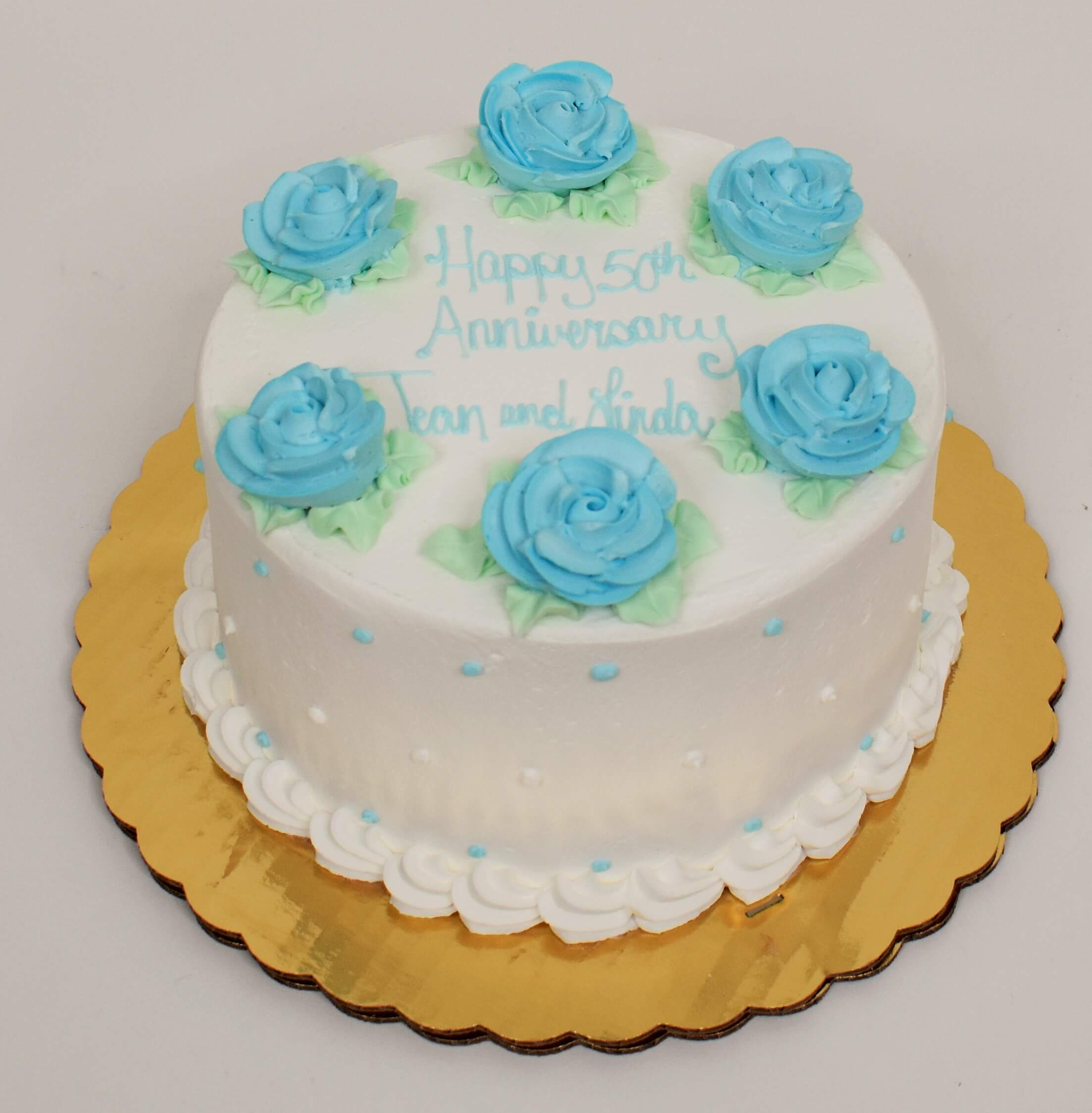McArthur's Bakery Custom Cake With Six Light Blue Roses