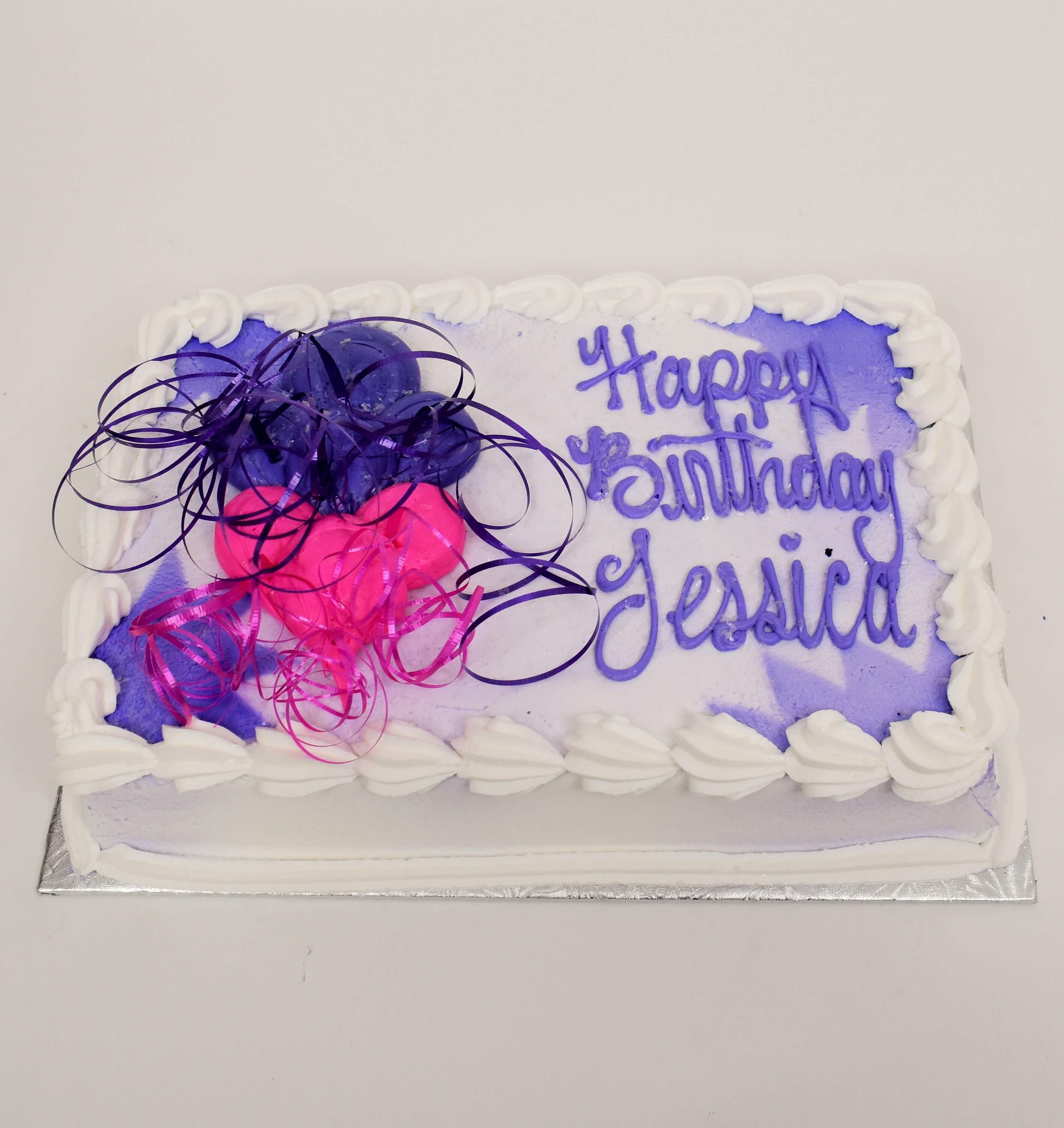McArthur's Bakery Custom Cake With Vibrant Purple And Pink Balloons