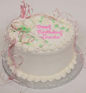 MaArthur's Bakery Custom Cake with White Roses, Green Leaves, Pink Ribbon.