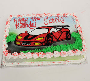 McArthur's Bakery Custom Cake with Red Lamboghini Sitting In Grass