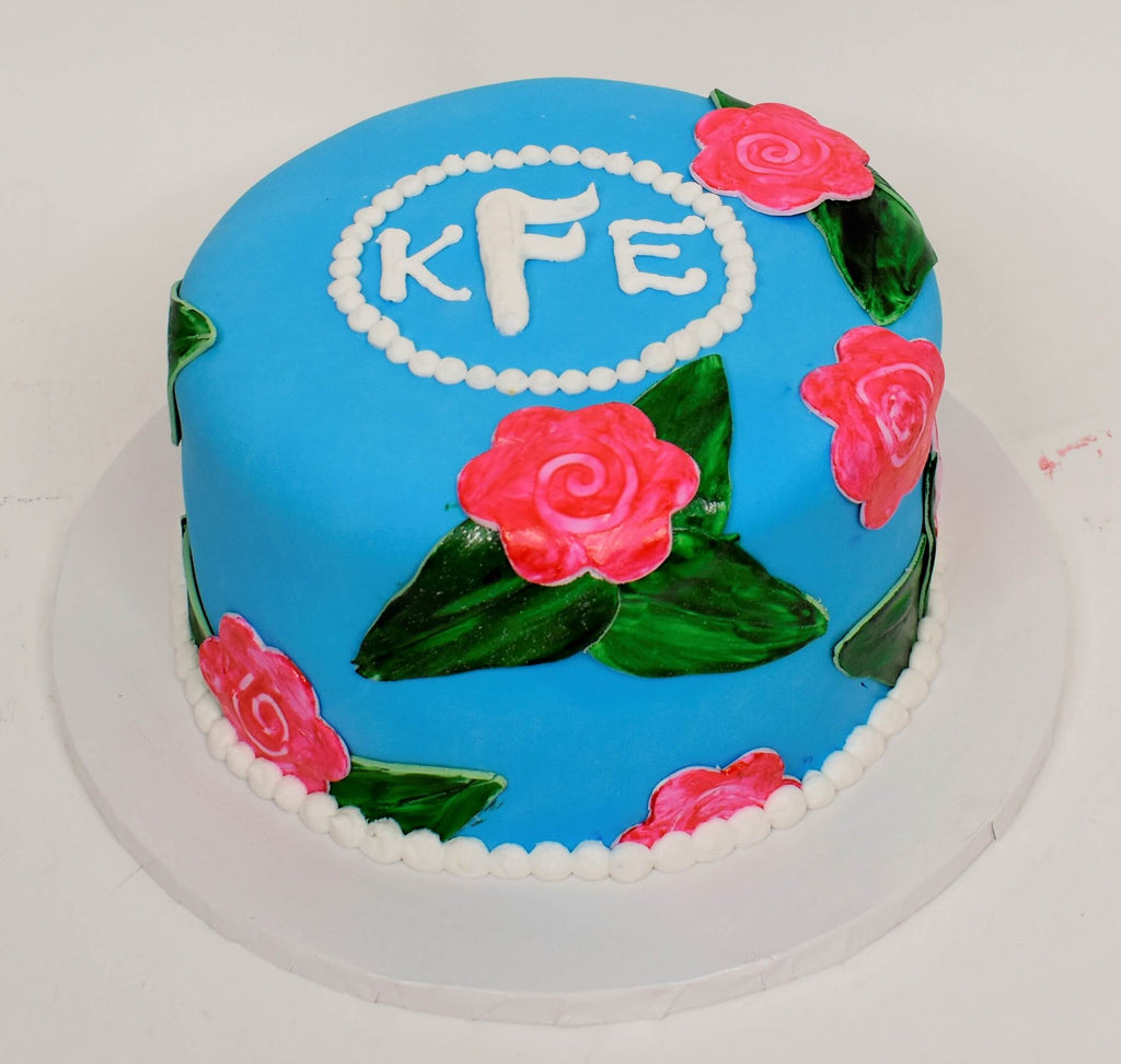 McArthur's Bakery Custom Cake With Monogram Initials And Roses On Blue