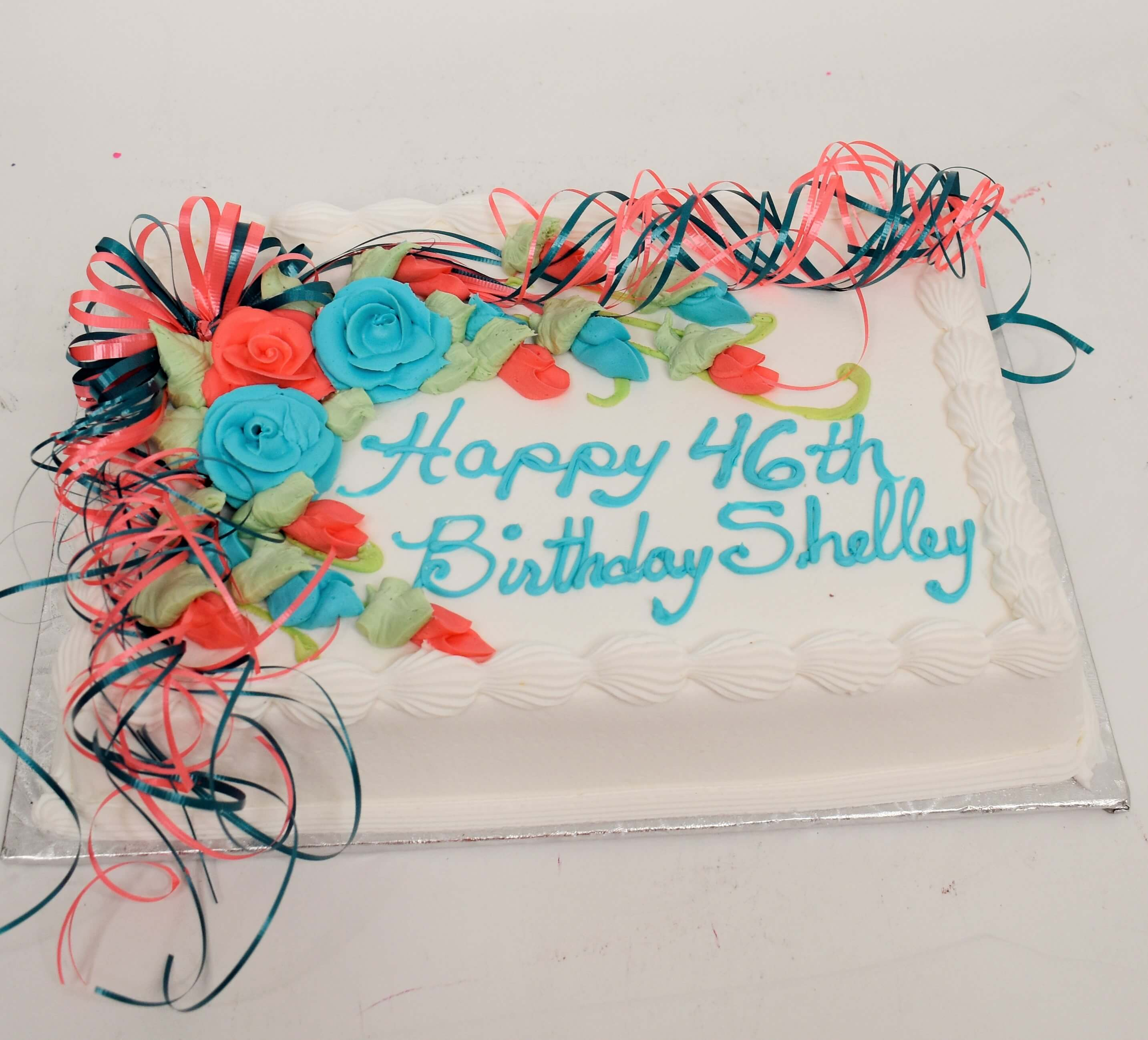McArthur's Bakery Custom Cake With Bright Pink And Bright Blue Roses
