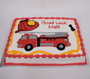 McArthur's Bakery Custom Cake With Firetruck and Fireman's Hat