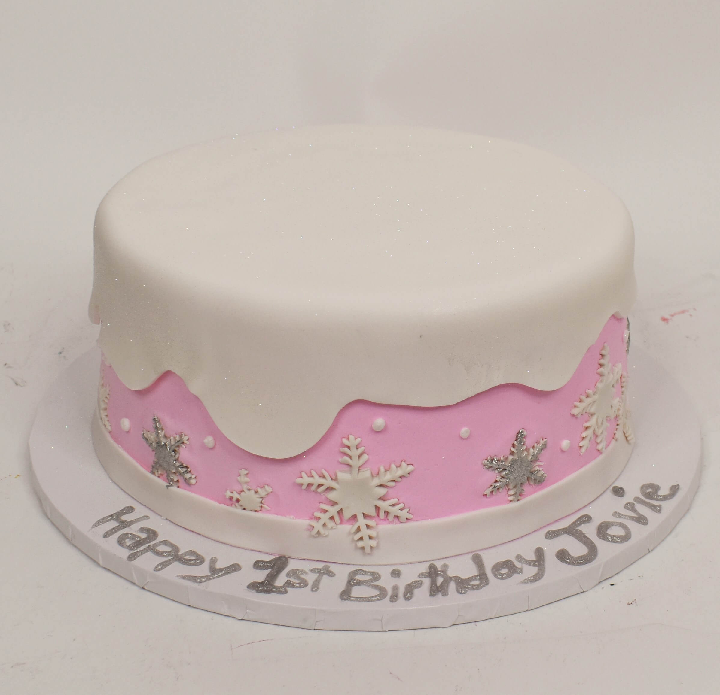 McArthur's Bakery Custom Cake With Snowflakes And Snow Cover