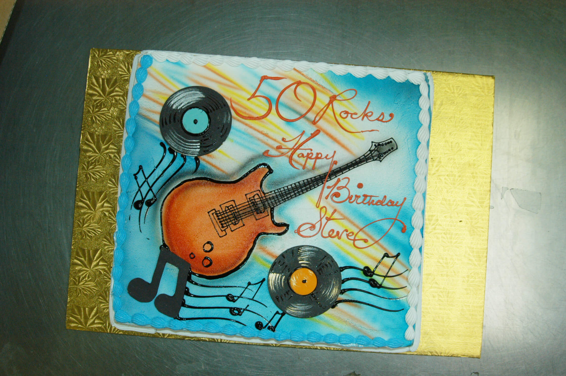 McArthur's Bakery Custom Cake with Guitar, Musical Notes, and Records
