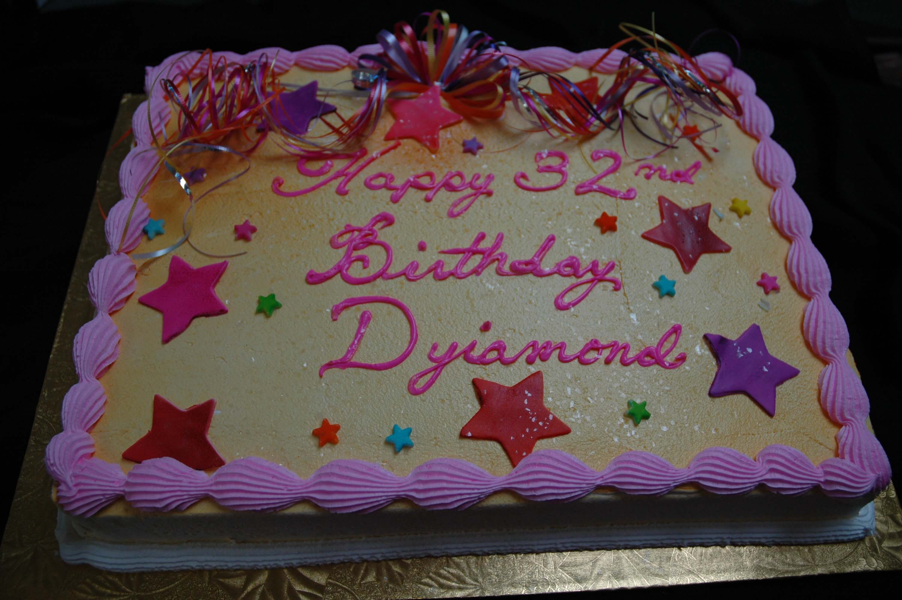 McArthur's Bakery Custom Cake with Stars and Ribbons
