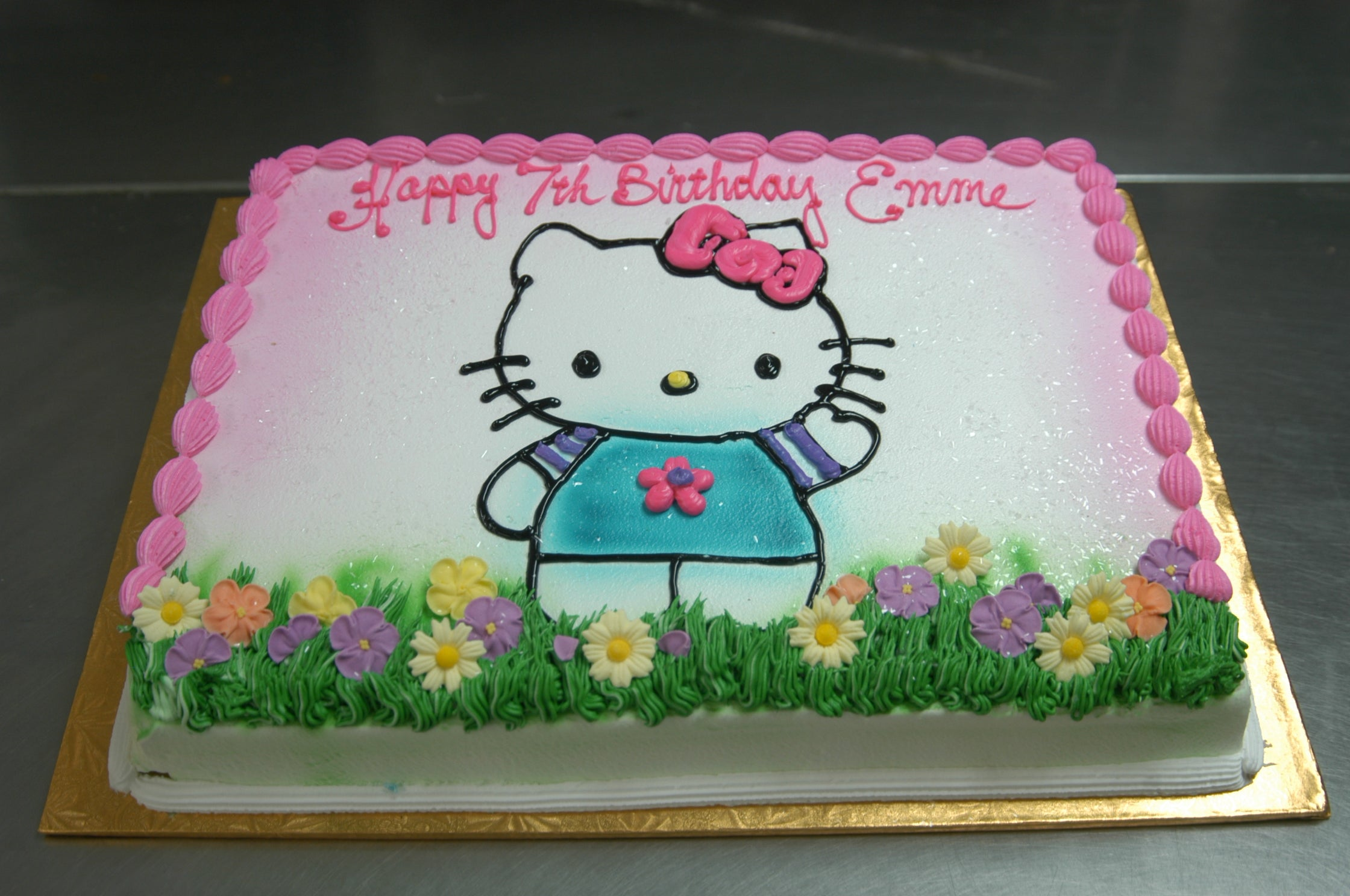 MaArthur's Bakery Custom Cake with Hello Kitty Standing on Flowers