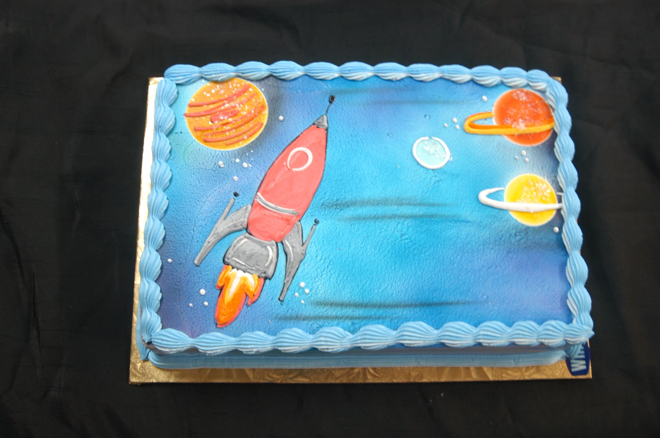 McArthur's Bakery Custom Cake with Rocket Ship and Planets Cake