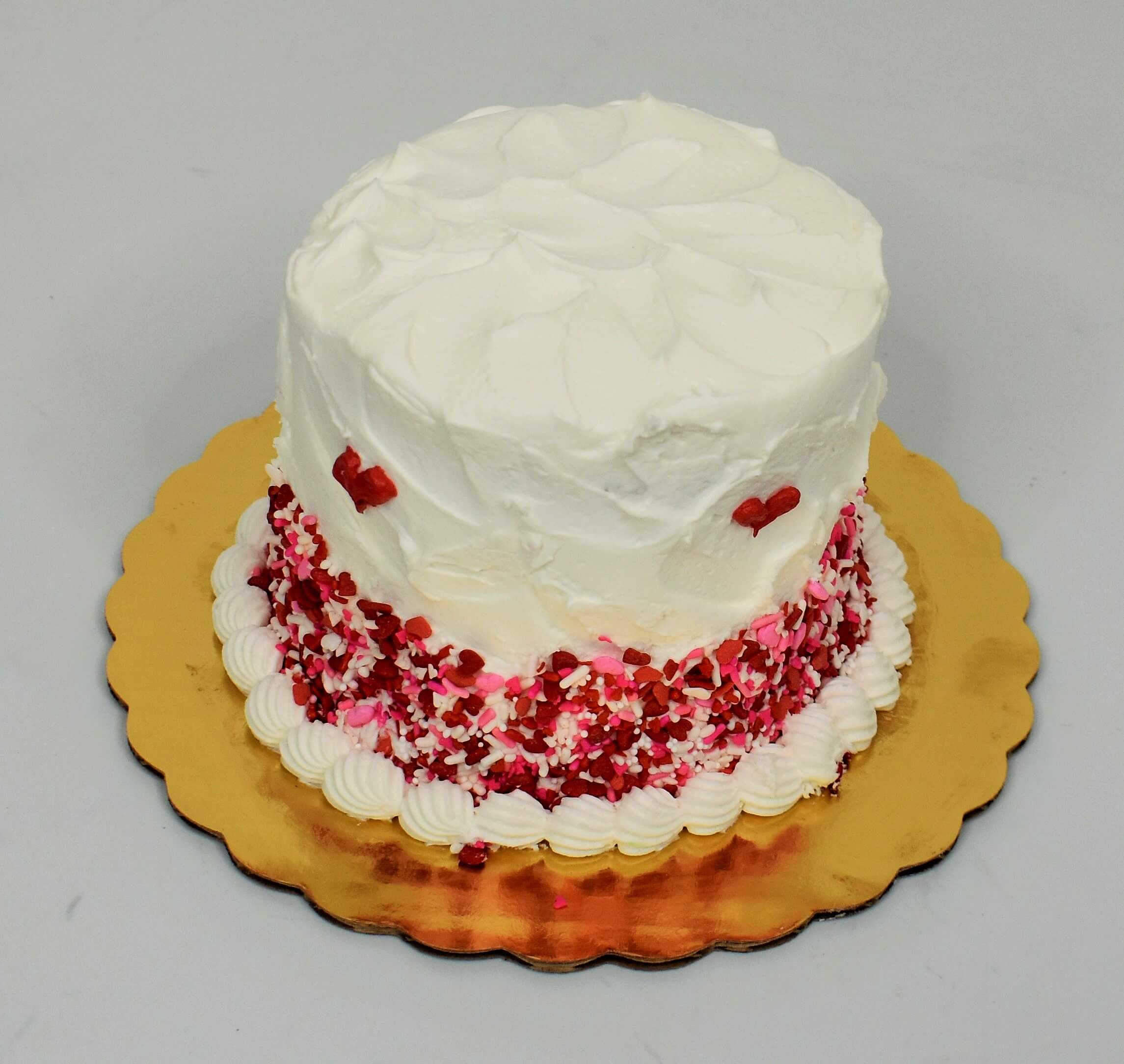 White Spatula Icing With Pink Sprinkles Cake