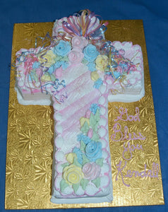 McArthur's Bakery Cake designed as a cross with colorful decorations.
