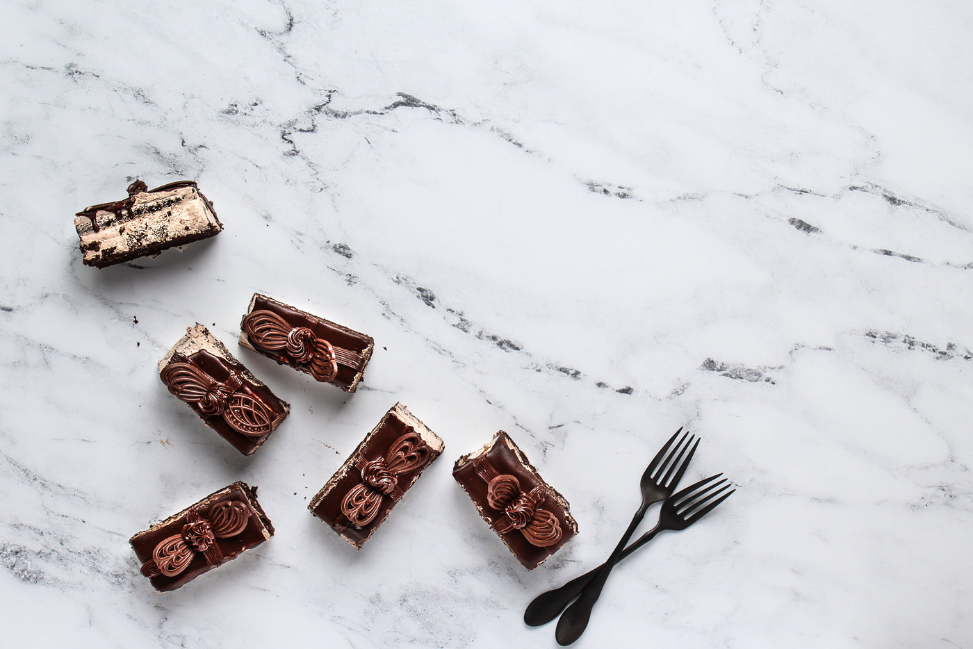 Marble Photography Backdrop 2 ft x 3 ft board | 3 mm thick with little chocolate cakes and forks